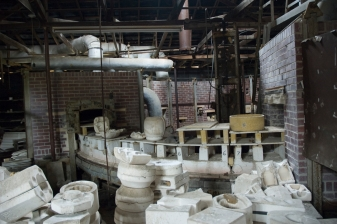 Arkansas Democrat Gazette photo by Cary Jenkins Interior of building that holds one of the tunnel kilns. Piles of plaster molds were throughout the building.Camark Pottery Factory, Camden Arkansas