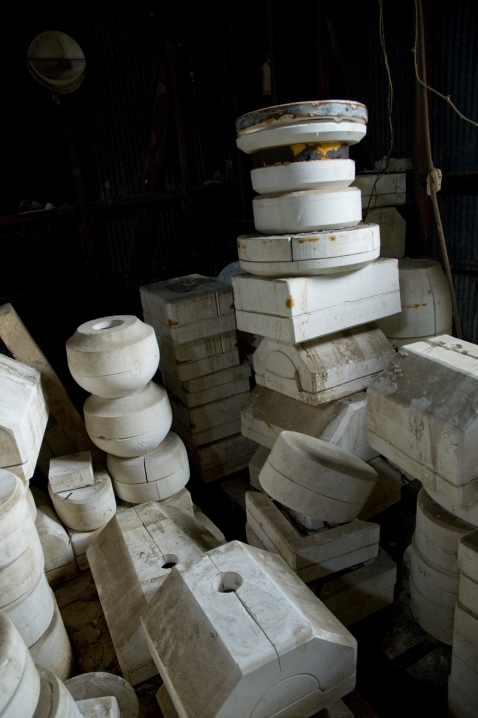 Arkansas Democrat Gazette photo by Cary Jenkins Stacks of plaster molds in one of the kiln roomsCamark Pottery Factory, Camden Arkansas